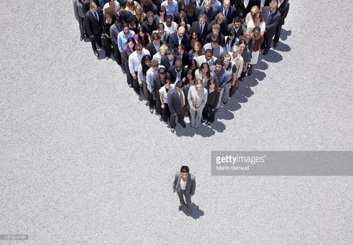 bird's-eye view of one person standing out from a clump of people total rewards and compensation