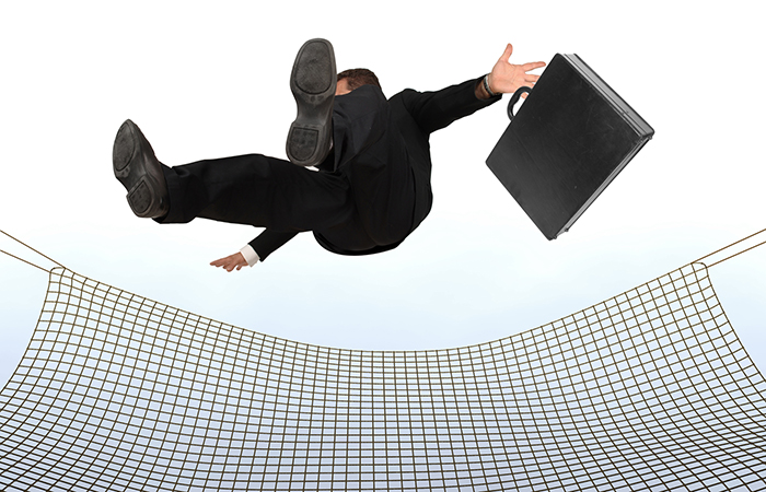 a businessman falling into a safety net shows why employees need disability coverage