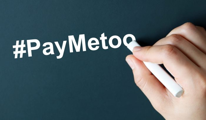 chalk board writing pay #metoo represents gender-pay inequity