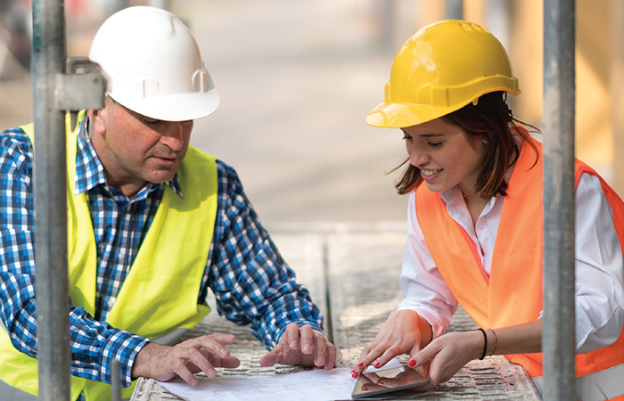 A man and woman in construction gear, represents the skilled-trade worker shortages and the need to renovate the skilled-trade workforce