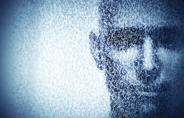 binary code in blue and white creates the figure of a man's face to represent why the c-suite needs digital leadership