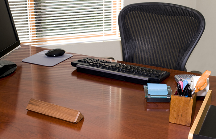 Empty desk and blank name plate for HR job titles and VP of people and culture