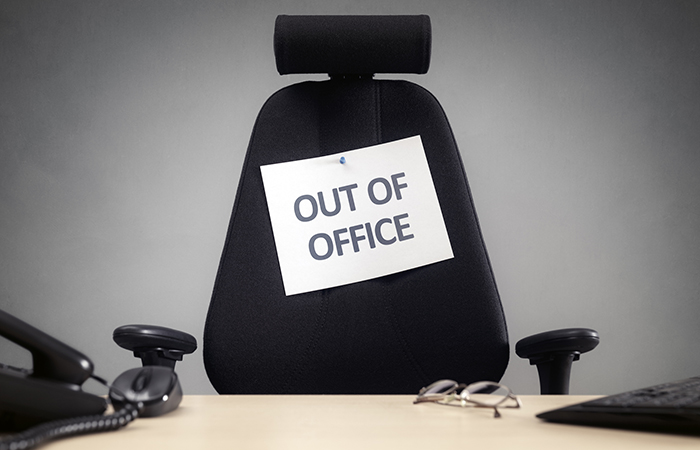 An out of office sign illustrates mandatory time off from work